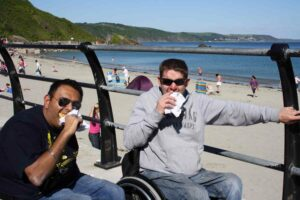 Stuart and his friend eating pasties on holiday